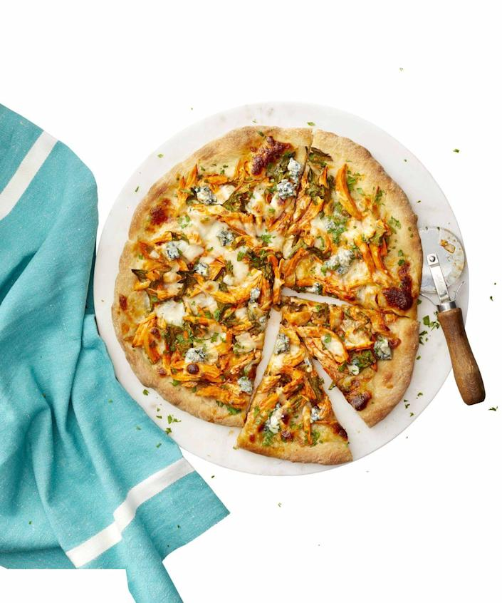 """<p>The blue cheese and the buffalo chicken in this pizza make for a flavorful meal.</p><p><a href=""""https://www.womansday.com/food-recipes/a25692226/buffalo-chicken-pizza-recipe/"""" rel=""""nofollow noopener"""" target=""""_blank"""" data-ylk=""""slk:Get the recipe for Buffalo Chicken Pizza."""" class=""""link rapid-noclick-resp""""><u><em>Get the recipe for Buffalo Chicken Pizza.</em></u></a></p>"""