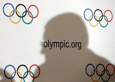 FILE PHOTO: IOC President Bach casts a shadow during a news conference after an Executive Board meeting in Lausanne