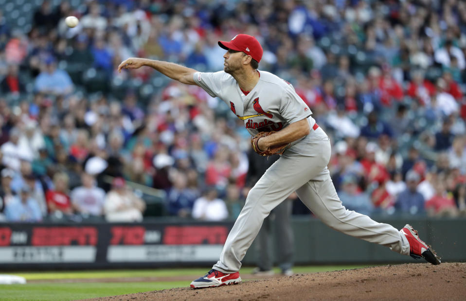St. Louis Cardinals starting pitcher Adam Wainwright throws to a Seattle Mariners batter during the second inning of a baseball game Wednesday, July 3, 2019, in Seattle. (AP Photo/Elaine Thompson)