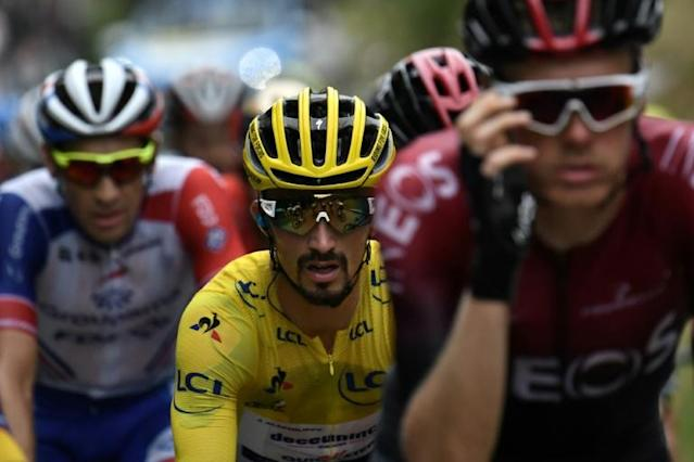 Julian Alaphilippe in the yellow jersey and champion Geraint Thomas in combat in the Pyrenees (AFP Photo/Marco Bertorello)