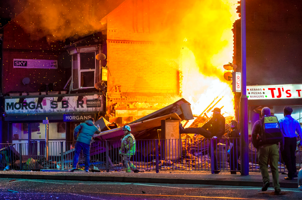<em>The building that exploded is believed to be a convenience store (SWNS)</em>