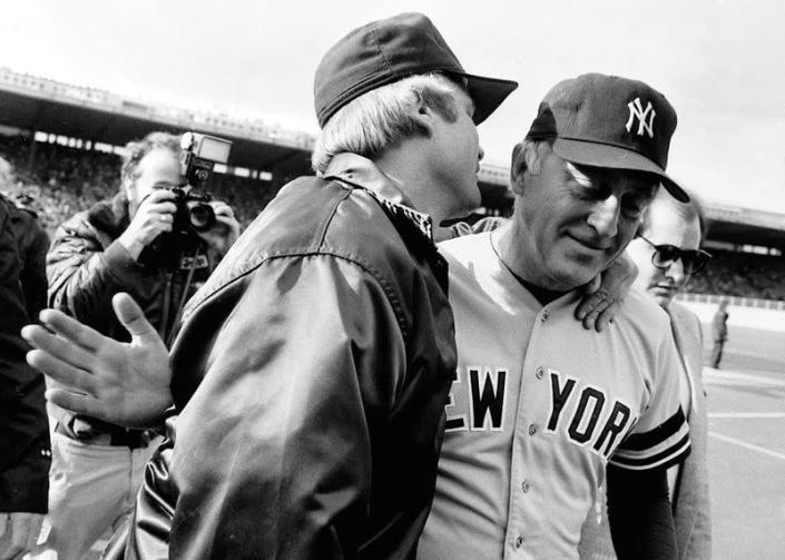 New York Yankees pitcher Phil Niekro is hugged by his brother Joe in Toronto