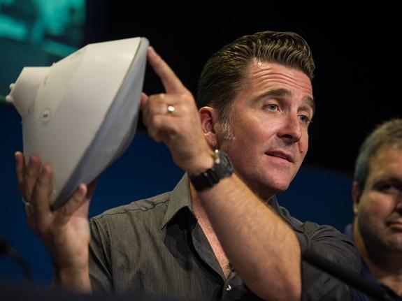 Adam Steltzner, NASA's Mars Science Laboratory entry, descent and landing phase lead, holds a model of the spacecraft during a briefing at the Jet Propulsion Laboratory Aug. 2, 2012 in Pasadena, Calif. The spacecraft will land the 1-ton rover C