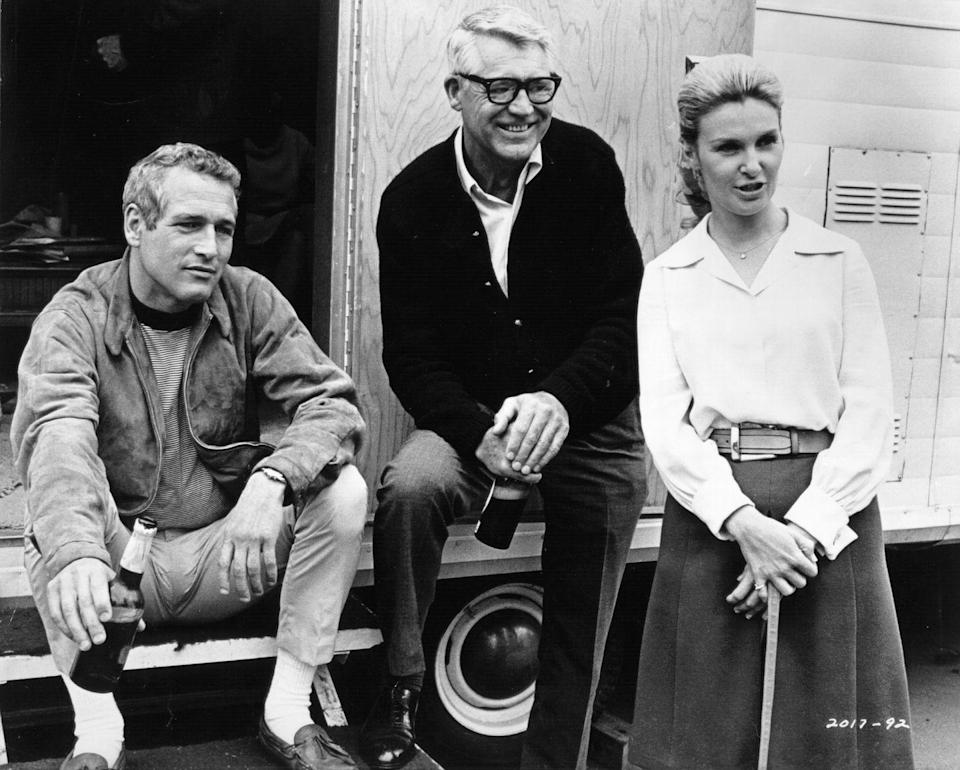 <p>Paul Newman, Cary Grant, and Joanne Woodard gather around a back lot trailer, circa 1965.</p>