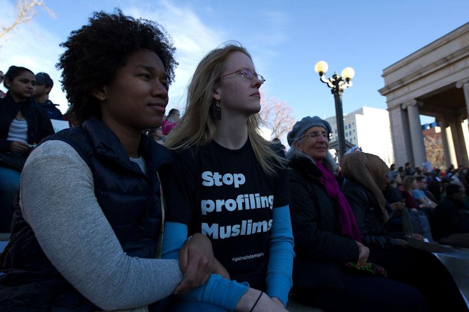 Anyeli Arias (L) and Sara Fossum (R) gather with thousands of people at Civic Center Park in Denver, Colorado for the Protect Our Muslim Neighbors Rally on February 4, 2017.