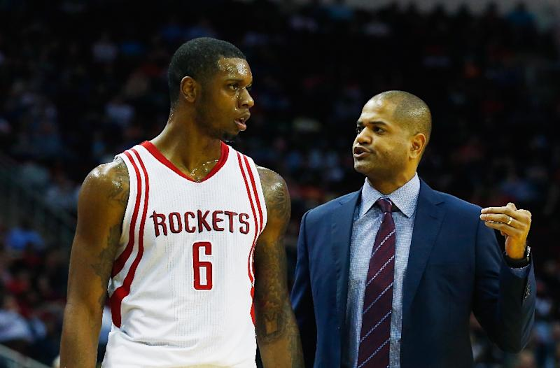 Interim head coach J.B. Bickerstaff of the Houston Rockets walks across the court with Terrence Jones #6 during their game against the Miami Heat on February 2, 2016 in Houston, Texas