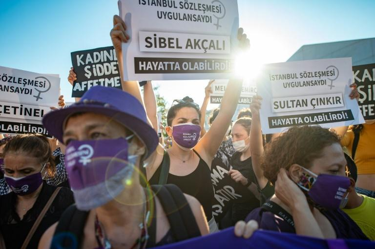 Demonstrators wearing protective face masks hold up placards during a demonstration for a better implementation of the Istanbul Convention and the Turkish Law 6284 for the protection of the family and prevention of violence against women, in Istanbul
