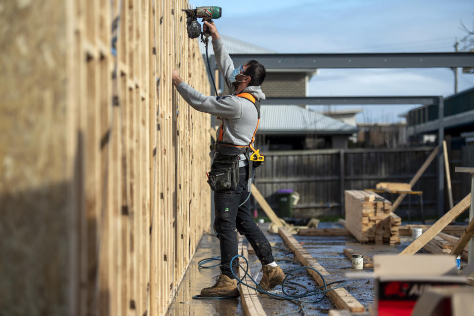 A builder works a on a construction site during lockdown due to the continuing spread of the coronavirus in Melbourne, Thursday, Aug. 6, 2020. Victoria state, Australia's coronavirus hot spot, announced on Monday that businesses will be closed and scaled down in a bid to curb the spread of the virus. (AP Photo/Andy Brownbill)