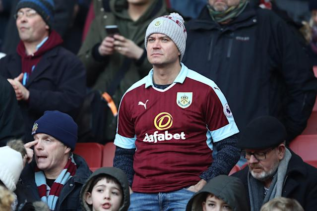 <p>Burnley fans take their place in the Emirates </p>