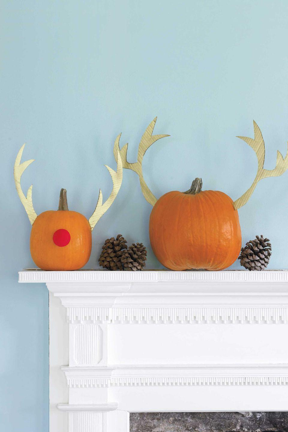 """<p>A mash-up of holidays makes for a very stylish display. Gold antlers and a Rudolph-inspired nose will take your gourds well into winter.</p><p><strong><em><a href=""""https://www.womansday.com/home/crafts-projects/how-to/a5982/craft-project-merry-mix-up-123880/"""" rel=""""nofollow noopener"""" target=""""_blank"""" data-ylk=""""slk:Get the Merry Mix-Up tutorial."""" class=""""link rapid-noclick-resp"""">Get the Merry Mix-Up tutorial.</a></em></strong></p>"""