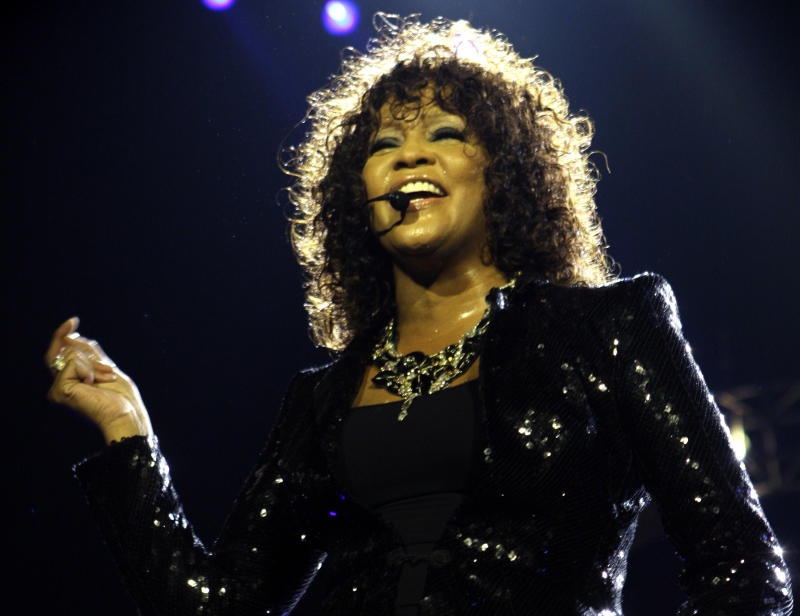 FILE - This April 25, 2010 file photo shows U.S singer Whitney Houston performing at the o2 in London as part of her European tour. The FBI has released its files on a trio of investigations the agency conducted on behalf of Whitney Houston. The records released Monday show the agency conducted one investigation into an alleged extortion attempt in 1992, but agents and prosecutors determined no crime occurred. Agents also found no evidence of criminal threats to the singer in fan mail that was sent to the FBI for investigation in 1988 and 1999. The 128-page file covers the height of the Grammy-winning singer's popularity but does not contain any new personal details.  (AP Photo/Joel Ryan, file)