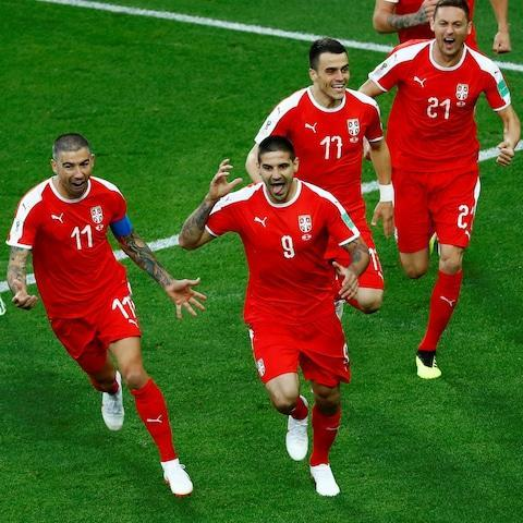"It was when Granit Xhaka and Xherdan Shaqiri celebrated their goals with the Albanian eagle salute that you knew just how much beating Serbia meant to them. Two players of Kosovan descent not only put Switzerland on the brink of the World Cup knockout stages but they struck a blow for the nation their opponents' government still refuses to recognise. Whatever Arsenal fans think of Xhaka, surely not even they would begrudge him what must have been one of the most emotional goals of this World Cup, with his father having been imprisoned for campaigning for the independence of Kosovo. His equaliser, cancelling out Aleksandar Mitrovic's early opener, kept Switzerland's Group E destiny in their own hands before Shaqiri put them firmly in control of it and left Serbia needing to beat Brazil to reach the last 16 for the first time since their country became independent itself. Shaqiri's stoppage-time winner sparked wild celebrations, the Stoke City winger tearing off his shirt before repeating Xhaka's earlier gesture, the significance of which he sought to play down afterwards. Shaqiri slots home the winning goal Credit: AFP ""In football, you have always emotions and at least you can see what I did and I think it's just emotion and I'm very happy to score this goal,"" he said. Both managers, at pains during the build-up to this fixture to steer pre-match talk away from the politics of it, refused to discuss the gestures of Xhaka and Shaqiri. Sarajevo-born Switzerland boss Vladimir Petkovic said: ""It's clear that emotions show up and that's how things happen. We, all together, need to stay away from politics in football and we should focus on this sport as a beautiful game and something that brings people together."" The first meeting of these two sides since the collapse of Yugoslavia had long been billed as a grudge match, given Shaqiri and team-mate Valon Behrami were both born in Kosovo and Xhaka's family was forced to flee from there. Shaqiri even speaks Albanian at home and has long worn boots bearing the flag of both his adopted country and birthplace, an online picture of which last month prompted a caustic response from Mitrovic. As well as earning their country a Fifa fine for a World War II-era banner in their World Cup opener in Samara, Serbia fans could apparently be heard singing ""Kosovo je Srbija"" (Kosovo is Serbia) in the city's bars after the game. In Kaliningrad, a place with its own complex history of nationhood, they made their feelings clear by jeering Switzerland's Balkan-blooded players from the moment their names were announced over the public address. The jeers turned to cheers when Serbia took the lead inside five minutes. Switzerland failed to learn their lesson as, first, Mitrovic climbed highest to connect with a header that Yann Sommer did well to repel, before the Newcastle United striker outmuscled Fabian Schar to power home Dusan Tadic's cross moments later. Blerim Dzemaili, another Balkan-born Swiss, screwed wide from Ricardo Rodriguez's cutback but Mitrovic was winning almost everything in the air. He also saw fit to barge into the back of Shaqiri in what was a visible reminder of the bad blood between them. Switzerland soon began finding their own chinks in their opponents' back line and would have equalised after half an hour but for a superb reflex save by Vladimir Stojkovic from Dzemaili. Aleksandar Mitrovic heads Serbia in front Credit: Getty Images But they looked like conceding from every high ball and would have done from a corner had Dusko Tosic not failed to connect with a free header and had Nemanja Matic been able to turn in the loose ball just before half-time. Needing a goal to avoid having to cheer on their opponents against Brazil on Wednesday, they got it soon after the restart thanks to Xhaka, who produced the kind of strike to leave Arsenal fans blinking in disbelief. Switzerland had only just avoiding conceding from another Mitrovic header from a corner when they launched an attack that saw the ball break to Xhaka, who lashed it home left-footed first time from 20 yards. In a breathless climax in which either side looked capable of snatching a winner, Mitrovic had a furious penalty appeal turned down for grappling, sparking another video technology row. Stojkovic was then called into serious action to deny Mario Gavranovic from fellow substitute Breel Embolo's knock-down. But given the politically-charged atmosphere, the clincher seemed destined to come from a Balkan and it was Shaqiri who provided it at the death. Serbia were on the attack when the ball was played forward to the winger, who stayed onside by remaining in his own half before out-sprinting his pursuer and slotting under Stojkovic. Serbia manager Mladen Krstajić refused to comment on the penalty incident and was defiant about his side's chances of upsetting Brazil. He said: ""Nothing is impossible in life. We respect their status as favourites to win but we are going to prepare. They have weak spots that we'll try to exploit."" 9:07PM Where does this leave the group Serbia need to beat Brazil on Wednesday unless Switzerland are beaten by Costa Rica by a couple of goals - a draw against Costa Rica will suffice for Switzerland. 9:03PM Opta's statistical pointers Switzerland's 2-1 victory over Serbia is the first game at the 2018 World Cup to see a side win from a losing position. As an independent nation, Serbia have lost each of the six World Cup matches in which they have conceded. Switzerland have lost just one of their last 24 matches (W17 D6), a 2-0 defeat by Portugal in a World Cup qualifier in October 2017. Stephan Lichtsteiner made his ninth World Cup appearance for Switzerland in this game – the most of any Swiss player in history. Aleksandar Mitrovic has been directly involved in 15 goals in his last 15 starts for Serbia (13 goals, 2 assists). Five of Granit Xhaka's 10 goals for Switzerland have come from outside the box. Only Josef Hügi (6 goals) has scored more World Cup goals for Switzerland than Xherdan Shaqiri (4, tied with Robert Ballamann & Andre Abegglen). Xherdan Shaqiri has been directly involved in five of Switzerland's last six World Cup goals (four goals, one assist). 9:02PM This seems about right Caught on the counter twice. Milivojevic sub was a bad one. We shouldn't have risked it all, a draw is much better than a loss.— Serbian Football (@SerbianFooty) June 22, 2018 Of course if Brych called that obvious penalty against Mitrovic things could have been different but we would have likely conceded anyway with the way we were playing.— Serbian Football (@SerbianFooty) June 22, 2018 We did score our goal way too early but that doesn't mean that you automatically have to sit back and absorb pressure right away. We could have won that game in the first half with a bit better approach. Congrats to the Swiss on a great fight.— Serbian Football (@SerbianFooty) June 22, 2018 8:58PM How they stand 8:54PM Full time Serbia 1-2 Switzerland Serbia were the better side for more than an hour, defended superbly until that late error and were robbed of a surefire penalty when Mitrovic was bodyslammed by Lichtsteiner and Schaer. They have every right to feel aggrieved. But you have to admire Switzerland's clinical finishing and the way they fought their way back into the game. Terrific match. 8:51PM 90+3 min Serbia 1-2 Switzerland Drmic replaces Zuber. Shaqiri isi booked for time-wasting. 8:50PM 90 min Serbia 1-2 Switzerland Akanji defends a cross, Tosic makes a terrible error of judgment on halfway, trying to play offside and steps up which lets Shaqiri run past him and through on goal from 50m. Tosic gives chase but he can't catch him despite his efforts. Out comes Stojkovic and Shaqiri waits for him to commit himself then pokes it under his dive with marvellous composure. Serbia 1 - 2 Switzerland (Xherdan Shaqiri, 90 min) 8:48PM Goal!! Serbia 1-2 Switzerland Shaqiri on the break and with the composure to slot it in. 8:47PM 89 min Serbia 1-1 Switzerland It's been a ding dong second-half, supremely enjoyable. Ivanovic stands tall at the cost of a corner. Rodriguez will take from the left. Mitrovic heads it clear from the penalty spot. Serbia have been brilliantly organised at the back and even the goal they conceded was the unfortunate result of a brave block. 8:45PM 87 min Serbia 1-1 Switzerland Radjonic tears 50m up the left and cuts inside to head from the box. Akanji has the speed and timing to slide in and knock it behind for a corner from which Mitrovic is penalised for holding. 8:44PM 85 min Serbia 1-1 Switzerland Switzerland free-kick 25m out for a Matic trip. Rodriguez hits it at the wall and it balloons out for a corner. Matic blocks a shot as the ball fell in the box from the cross. Serbia break. 8:43PM 83 min Serbia 1-1 Switzerland Embolo wins a header and flick it behind the defence and Gavranovic in an undetected offside position scoops his shot at Stojkovic who, after the scare a minute ago, recovers his poise and saves smartly. 8:40PM 81 min Serbia 1-1 Switzerland Embolo has a dig from 20m and achieves power without precision though Stojkovic palms it down as it's too hot to grasp at first attempt. 8:38PM 79 min Serbia 1-1 Switzerland Kolarov wins a key header at the back post. Switzerland lay siege from 30m out and continue to probe until Xhaka's pass over the top is overclubbed and skips out of play fr a goalkick. Milivojevic is the one to make way for Radonjic, a defensive midfielder for a forward. 8:37PM 78 min Serbia 1-1 Switzerland Top class defending from Milenkovic. The Red Star striker Radonjic is about to come on. 8:36PM 77 min Serbia 1-1 Switzerland Ljajic shoots, cutting inside on to his right from the left, but his shot is blocked and Switzerland break at pace, Shaqiri scurrying forward, the 'Magic Cube' accelerating towards the box, feinting this way and that. Milenkovic, though, keeps his eyes on the ball and doesn't buy the dummies. 8:34PM 75 min Serbia 1-1 Switzerland Rodriguez is having his mouth swabbed for blood, claiming he was elbowed in the universal language of mime. He has to change his shirt and comes on with bloody teeth, like a claret drinker or Dracula. 8:32PM 73 min Serbia 1-1 Switzerland Xhaka, from a mile offside and clear through on goal from the left, skewers his shot into the side-netting. The linesman lets the phase end before he flags. 8:31PM 71 min Serbia 1-1 Switzerland Switzerlnd sub: Embolo on for Dzemaili. Lichtsteiner and Schaer double team Mitrovic and should have been penalised Credit: Ryan Pierse/Getty Images 8:28PM 68 min Serbia 1-1 Switzerland A fine pass form Milikovic-Savic sends Kolarov clear down the left and the captain pings in a daisy-cutter through the six-yard box. Mitrovic doesn't expect it to reach him at the back post so doesn't accelerate but it does elude the defence and he misses it by half a metre or so. For want of a nail ... Serbia vs Switzerland shots on goal 8:25PM 66 min Serbia 1-1 Switzerland Brilliant cross from Tadic to the back post where Mitrovic is wrestled to the ground by Lichtsteiner and Schaer. Both had their arms wrapped around him as he went up to win the header and grappled him to the ground. That was a stonebonker of a penalty. They double-teamed him and yet the VAR bottles it and the referee ignores it. 8:22PM 64 min Serbia 1-1 Switzerland That was Kostic's last act - he is replaced by Ljajic of Torino who started the Costa Rica game. 8:22PM 63 min Serbia 1-1 Switzerland Kostic betrays his frustration with the referee after a tight throw-in call is wrongly given the other way. 3 yellow cards from 7 Serbia fouls ? really Felix Brych? did we just throw out warnings for this match?— Serbian Football (@SerbianFooty) June 22, 2018 8:19PM 61 min Serbia 1-1 Switzerland Milinkovic-Savic receives a final warning for tussling with Behrami. He has already been booked. Xhaka takes a moment after equalising Credit: ATTILA KISBENEDEK/AFP/Getty Images 8:17PM 58 min Serbia 1-1 Switzerland Shaqiri, dances around Kolarov on the right, turns and moves a couple of metres back towards his own goal then bends a scorching shot towards the top left corner that shaves the outside of the joint where the post meets the crossbar. Xhaka fires in Switzerland's equaliser Credit: Dan Mullan/Getty Images 8:15PM 56 min Serbia 1-1 Switzerland Gavranovic has made an instant impact and improvement. He is running the channels hard and getting behind the veteran Ivanovic, testing his ability to turn quickly and putting some pain into his legs. 8:13PM 54 min Serbia 1-1 Switzerland It looked like the chance had gone when Shaqiri fired his left-foot shot on the break at Kolarov. The ball ricochets out to Xhaka who has been so loose in possession but can still strike a killer shot. It comes to him 22m out and he thrashes it with his left-foot across goal from the left and into the right corner. Utterly unstoppable. Mitrovic should really have scored with that header and yet 20 seconds later their lead instead of being doubled has gone. Pass: Serbia 1 - 0 Switzerland (Ricardo Rodríguez, 26 min) 8:10PM Goal!! Serbia 1-1 Switzerland Xhaka with a left-foot screamer. 8:10PM 52 min Serbia 1-0 Switzerland Careless Xhaka gives the ball to Tadic who links up with Milinkovic-Savic and Mitrovic at the edge of the box. They play slick passes, Mitrovic holds off Schaer and they win a corner from which Mitrovic sends a towering header over the bar. 8:08PM 51 min Serbia 1-0 Switzerland Rodriguez overhits a cross from the left sending it sailing beyond the back post and out for a throw. Gavranovic won the header to play him in having fought to be on the end of Shaqiri's diagonal pass. 8:07PM 50 min Serbia 1-0 Switzerland Zuber makes hay on the left and gets past Ivanovic when he is found by a crossfield pass but he had strayed offside. 8:06PM 48 min Switzerland begin the half on the front foot and pass it around, probing left and right as Shaqiri is give a free role at the start. 8:04PM 46 min An understandable and overdue switch. Robert Rosario and Jason Lee were more prolific than Seferovic threatened to be. 8:03PM Half-time substitution Mario Gavranovic of Dinamo Zagreb replaces Haris Seferovic for Switzerland. 7:53PM Record-breakers Cue Roy Castle: Mitrovic scores for Serbia and that equals the record for consecutive games at a World Cup without a goalless draw. 26 games, the same as in Switzerland in 1954 when every single game had a goal. Just knockout in those days.— Gary Lineker (@GaryLineker) June 22, 2018 7:50PM Half-time As they depart Shaqiri and Mitrovic, who has been outstanding, have a chat about an off-the-ball collision at a corner in the first half. Was it deliberate, Mitrovic catching Shaqiri on the side of his head? Mitrovic is explaining himself, making the case that it was an accident. 7:48PM 45+3 min Serbia 1-0 Switzerland Matic is booked for flattening Lichtsteiner. And that's the half. 7:47PM 45+2 min Serbia 1-0 Switzerland In the last minute of added time Tadic flays a left-foot shot that trims the top of the crossbar. He caught it so crisply from 20m out that you could almost hear the 'whoosh' on the boom microphone. 7:46PM 45 min Serbia 1-0 Switzerland Switzerland fall apart at the corner losing their men and their shape when Tadic whips it into the box from the right. Tosic dives in and would have scored had he timed his leap properly but instead he is to late and flies under the ball. Panic stations in the box but Switzerland get away with it by the skin of their teeth. 7:44PM 43 min Serbia 1-0 Switzerland Serbia break free on the counter down the left but the cross is too floaty. Then Milinkovic-Savic, who treasures the ball like Swiss Toni and a beautiful woman, kills a firm pass with a lovely touch, takes it in his stride and plays it down the right for Tadic whose cross is blocked behind for a corner. 7:42PM 41 min Serbia 1-0 Switzerland At last Switzerland try to pick the lock with a pas slid down the inside left channel where Tosic beats Dzemaili to it by a toenail. 7:40PM 39 min Serbia 1-0 Switzerland Yellow card for Milivojevic for a mistimed sliding tackle on Shaqiri 15m inside the Serbia half. Switzerland move it across the field from right to left and back again but they keep getting crowded out by the compact midfield and defence. 7:39PM 37 min Serbia 1-0 Switzerland Scaher shoves Mitrovic in the back as the centre-forward tried to shield a cross just to the left of the box. Kolarov will take. He chips it to the near post for Mitrovic's run but a defender wins the header and clears it to the edge of the box. Tadic hits it sweetly on the half-volley but Sommer saves it in relative comfort even it it momentarily stings his palms. Here's Stojkovic's save: Stojkovic thwarts Dzemaili Credit: PATRICK HERTZOG/AFP/Getty Images 7:35PM 35 min Serbia 1-0 Switzerland Yellow card for Milinkovic-Savic who went into a 30-70 challenge for a bouncing ball with Schaer and had his leg raised so high, he studded his opponent in the hip. 7:34PM 33 min Serbia 1-0 Switzerland Dearie me, that's terrible from Dzemaili who is put through the inside-left channel with Milenkovic slow to turn. But instead of shooting he scoops the ball from left to right across the area and ends the threat. At least I think that's what he was doing, trying to cross it. If it was a shot, it was even worse. 7:32PM 31 min Serbia 1-0 Switzerland Smart save from Stojkovic, low to his right from 8m when Dzemaili was played through by a cute, dinked pass from Zuber in the inside-right channel. Stojkovic got down quick and used his strong right wrist to divert it behind. That kind of zip, moving the ball at a fair old lick, unsettled Serbia. Attempt Saved: Serbia 1 - 0 Switzerland (Blerim Dzemaili, 30 min) 7:29PM 29 min Serbia 1-0 Switzerland Lichtsteiner's courageous sliding block concedes a throw-in high up the pitch in Serbia's half but thwarted he centre-half's plan to free Mitrovic through the middle. 7:28PM 27 min Serbia 1-0 Switzerland Xhaka is penalised unjustly for a fair if ungainly tackle on Milivojevic. 7:27PM 25 min Serbia 1-0 Switzerland Tadic tracks Rodriguez diligently as the Milan full-back chases a long diagonal chip. Tadic watches the ball and nods it out as he backpedalled, safety first. Rodriguez sends in the corner and Mitrovic heads it clear. Serbia vs Switzerland 7:24PM 23 min Serbia 1-0 Switzerland Milenkovic stops Shaqiri's thrusting run at the edge of the Serbia area and plays it up the right for Mitrovic to break. he has many qualities but not searing pace and Akanji closes him down and the two collide with a meaty thud. 7:23PM 21 min Serbia 1-0 Switzerland Kostic is played in round the back, behind Lichtsteiner and enters the box from the left. Akanji manages to intercept and scramble it clear. Serbia take the lead Credit: REUTERS/Fabrizio Bensch 7:20PM 18 min Serbia 1-0 Switzerland It's a terrific game so far. Serbia are slick and powerful. Tadic plays it out to Ivanovic who sends a deep outswinging cross to the edge of the penalty area. Mitrovic, who has Schaer cowering in his back pocket, takes it on his chest, swivels and floats a 20m bicycle kick over the bar. 7:18PM 15 min Serbia 1-0 Switzerland Milinkovic-Savic storms forward, tacking from centre to right and, when the defence dissolves in front of him, he whacks a right-foot shot from juts outside of the area, aiming for the top left corner but pulls it wide of his target. A minute earlier Kostoc had tiptoed through the box from the left and scooped a clever cross over Schaer, a bit of an up and under, but Rodriguez managed to get in the way. Possession: Serbia vs Switzerland 7:15PM 13 min Serbia 1-0 Switzerland Mitrovic's dander and confidence are up and he's thriving on early crosses but takes this one on from too far out, trying to beat Sommer from 20m and flashes it over the bar. 7:12PM 10 min Serbia 1-0 Switzerland Rodriguez makes progress up the left, jinks past Ivanovic to the byeline, then drags back a low pass through the box for Dzemaili who has a clear path to goal form 15m but hooks his left-foot shot wide of the right post. His body shape was all wrong. Here's the goal: Mitrovic puts Serbia into an early lead Credit: Clive Rose/Getty Images 7:10PM 8 min Serbia 1-0 Switzerland Switzerland corner, taken by Shaqiri from the right. Akanji wins the header and flashes it across the box but Matic is there to stop Shaqiri latching on to it. Switzerland are passing it around, probing patiently. 7:08PM 6 min Serbia 1-0 Switzerland Switzerland lost the ball on the left side of their defence about half a minute after Milivojevic had a crisp header saved. Tadic takes it to the corner flag and cuts back on to his left foot to bend in an inswinger towards the centre of goal. Mitrovic makes an angle run across goal, beasts Schaer in the air and steers his header wide of Sommer. Serbia 1 - 0 Switzerland (Aleksandar Mitrovic, 5 min) 7:06PM Goal! Serbia 1-0 Switzerland Mitrovic buries it, heading on Tadic's right-wing cross. 7:05PM 4 min Serbia 0-0 Switzerland Shaqiri rolls the ball across the park for Akanji who is marauding up the left. He switches it back out to Shaqiri on the right who pings it infield for Xhaka. He takes a touch, accepts the invitation to shoot that is implied by Serbia not closing him down but slices a 25m shot over the bar. 7:03PM 2 min Serbia 0-0 Switzerland Serbia free-kick 10m into the Switzerland half. Kolarov takes and drives a long diagonal. Mitrovic tries to feed on the scraps of the knockdown but Behrami holds him off and keeps him away from the ball in the box. 7:01PM 1 min Serbia 0-0 Switzerland The Serbian anthem was belted out by large swathes of the crowd. The team have based themselves in Kaliningrad and they have plenty of supporters in the stadium. Serbia build an attack up the right and Zuber comes back to help out Rodriguez. 6:56PM Time for the national anthems Tache of the tournament Credit: OZAN KOSE/AFP The Swiss Psalm is even more funereal than our own. 6:54PM The BBC pundits Favour a draw. I'm hoping Switzerland will feel that they have to go for three points in the knowledge that Serbia are capable of getting a point against Brazil. Serbia are in red, Switzerland in white. 6:33PM Meet Vladimir Petkovic Vladimir Petkovic succeeded Ottmar Hitzfeld as Switzerland manager after the 2014 World Cup and was sacked by Lazio in January of that year for agreeing to take the job. The Bosnian Croat won the Coppa Italia in his first season at the Stadio Olimpico and had managed six Swiss clubs since ending his playing career in 1997, most notably three years and a league runners-up place with Young Boys. Petkovic took Switzerland to the last 16 at Euro 2016 where they were knocked out in a penalty shootout by Poland Credit: ATTILA KISBENEDEK/AFP/Getty Images Until he took that job in Bern in 2008 Petkovic had combined his football career with working for the Catholic Caritas homeless charity in Locarno and his 'moral character' was singled out by the Lazio owner as the reason for hiring such a relatively unknown and unsuccessful coach. 6:22PM Fancy impersonating VAR? What have you come as? test - do not delete How VAR could have changed past World Cups 6:08PM And finally those teams in the classical style Serbia Stojkovic; Ivanovic, Milenkovic, Tosic, Kolarov; Matic, Milivojevic; Tadic, Milinkovic-Savic, Kostic; Mitrovic. Substitutes Rukavina, Spajic, Zivkovic, Prijovic, Rajkovic, Veljkovic, Rodic, Grujic, Ljajic, Radonjic, Jovic Dmitrovic. World Cup record: Serbia Switzerland Sommer; Lichtsteiner, Schär, Akanji, Rodriguez; Xhaka, Behrami; Shaqiri, Dzemaili, Zuber; Seferovic. Substitutes Moubandje, Elvedi, Lang, Embolo, Freuler, Mvogo, Fernandes, Gavranovic, Drmic, Djourou, Bürki. World Cup record: Switzerland Referee Felix Brych (Ger) 6:01PM Spoiler alert Ninety minutes' ebb and flow can be a bit of a distraction for some. If you'd like to know the final score now, have a go on the Telegraph's ingenious prediction brain: World Cup 2018 Simulator Single Game 5:58PM The rumours were true One change - Kostic replaces Ljajic. Startnih 1⃣1⃣ 