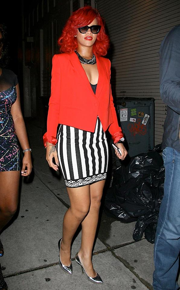 """Red locks? Check. Red lips? Check. Red blazer? Check. Rihanna looking ridiculous? Check. T/<a href=""""http://www.x17online.com"""" target=""""new"""">X17 Online</a> - September 28, 2010"""