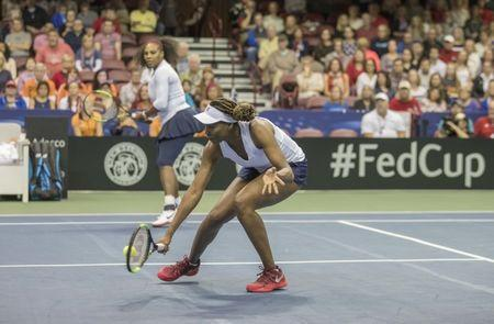 Feb 11, 2018; Asheville, NC, USA; Venus Williams (USA) and Serena Williams (USA) in action during their Fed Cup match against Venus Williams (USA) at U.S. Cellular Center. Mandatory Credit: Susan Mullane-USA TODAY Sports