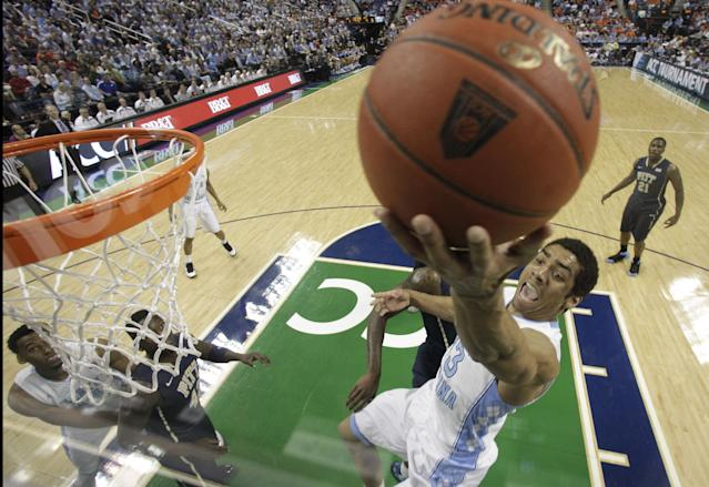 North Carolina's James Michael McAdoo goes to the basket against Pittsburgh during the first half of a quarterfinal NCAA college basketball game at the Atlantic Coast Conference tournament in Greensboro, N.C., Friday, March 14, 2014. (AP Photo/Bob Leverone)