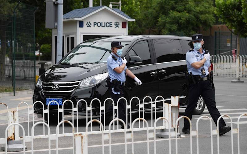 Chinese police patrol outside the Indian embassy in Beijing - AFP