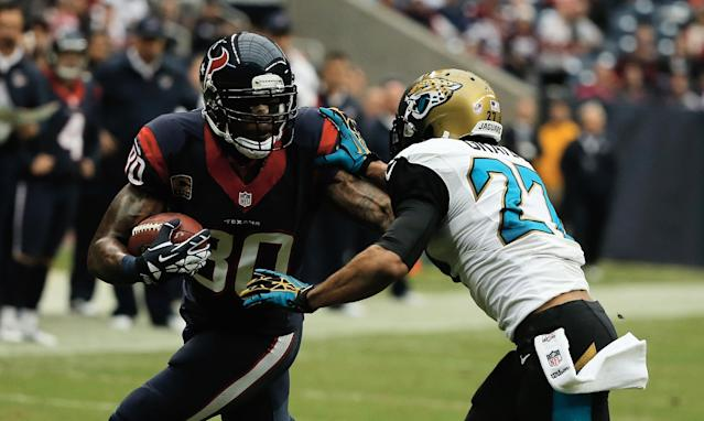 HOUSTON, TX - NOVEMBER 24: Andre Johnson #80 of the Houston Texans runs with the ball against Dwayne Gratz #27 of the Jacksonville Jaguars in the second half at Reliant Stadium on November 24, 2013 in Houston, Texas. (Photo by Scott Halleran/Getty Images)