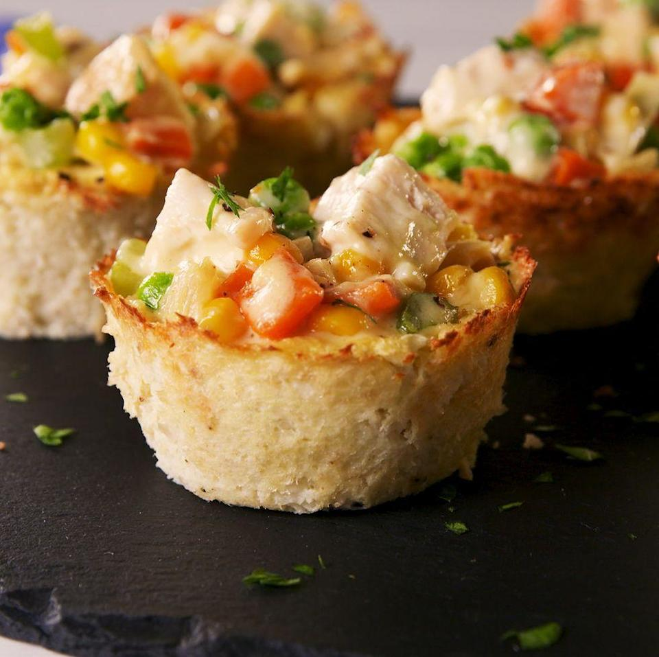 """<p><a href=""""https://www.delish.com/uk/cooking/recipes/a30146613/easy-homemade-chicken-pot-pie-recipe/"""" rel=""""nofollow noopener"""" target=""""_blank"""" data-ylk=""""slk:Chicken Pot Pie"""" class=""""link rapid-noclick-resp"""">Chicken Pot Pie</a> is one of our all-time favourite comfort foods. It's creamy, hearty, and... full of carbs. This version harnesses the power of riced cauliflower (and a bit of cheese) to make a crust that's super delicious and super healthy. Win/win!</p><p>Get the <a href=""""https://www.delish.com/uk/cooking/recipes/a34959273/low-carb-pot-pies-recipe/"""" rel=""""nofollow noopener"""" target=""""_blank"""" data-ylk=""""slk:Low Carb Chicken Pot Pies"""" class=""""link rapid-noclick-resp"""">Low Carb Chicken Pot Pies</a> recipe.</p>"""