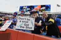 Fans holds signs during the first half of an NFL football game between the Buffalo Bills and the Pittsburgh Steelers in Orchard Park, N.Y., Sunday, Sept. 12, 2021. (AP Photo/Adrian Kraus)