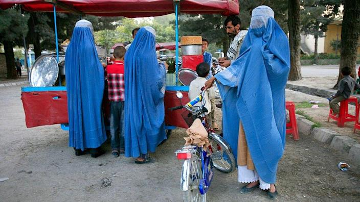 Afghan man with his three wives in Kabul
