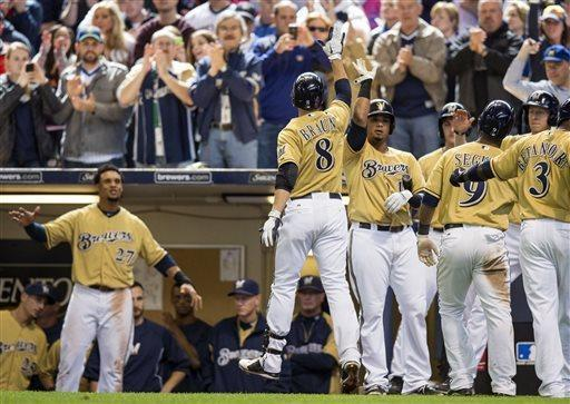Milwaukee Brewers' Ryan Braun is greeted by his teammates after hitting a three-run home run off of Chicago Cubs' Scott Feldman during the fifth inning of a baseball game on Sunday, April 21, 2013, in Milwaukee. (AP Photo/Tom Lynn)