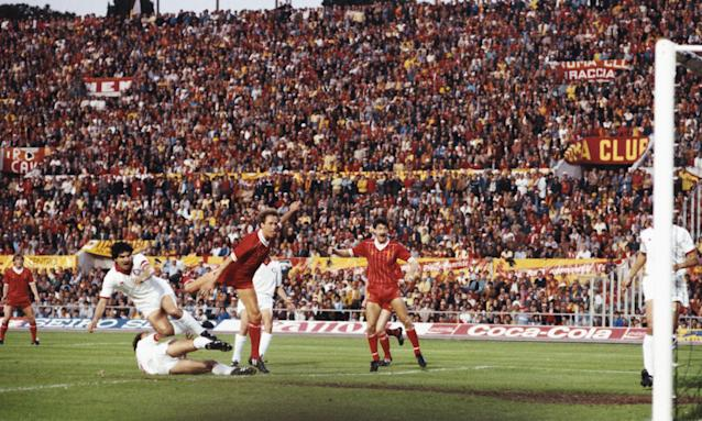 Liverpool striker Ian Rush celebrates as full-back Phil Neal scores the Liverpool goal during the 1984 European Cup final between Liverpool and Roma.
