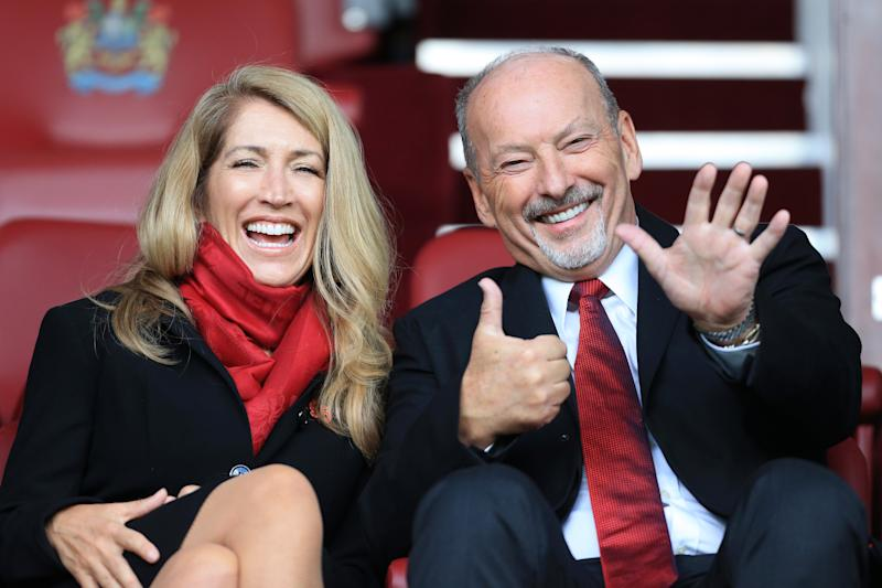 BURNLEY, ENGLAND - AUGUST 31: Liverpool Chief Executive Peter Moore and his wife, Debbie Moore, look on before the Premier League match between Burnley and Liverpool at Turf Moor on August 31, 2019 in Burnley, United Kingdom. (Photo by Simon Stacpoole/Offside/Offside via Getty Images)