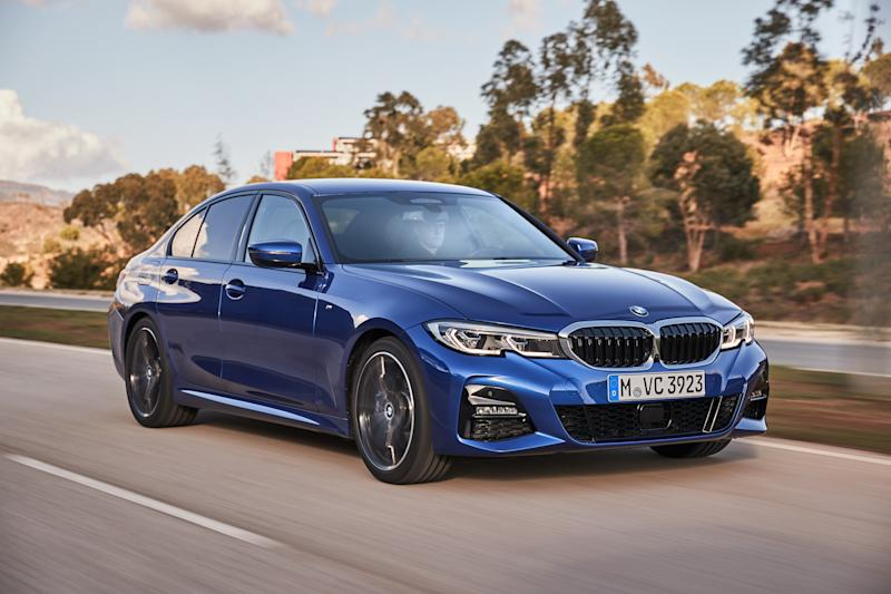 A blue 2020 BMW 330i, a compact luxury-sports sedan.