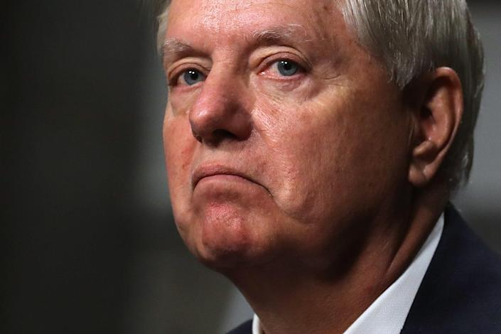 Calls have been made for Donald Trump ally Lindsey Graham to resign over his controversial Georgia ballots phone call (POOL/AFP via Getty Images)