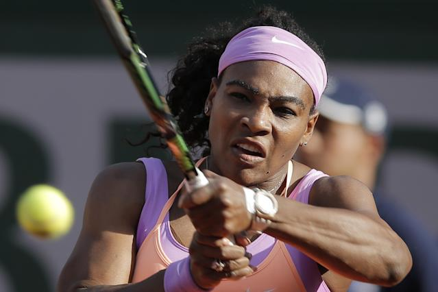 Serena Williams of the U.S. returns in the third round match of the French Open tennis tournament against Victoria Azarenka of Belarus at the Roland Garros stadium, in Paris, France, Saturday, May 30, 2015. (AP Photo/Christophe Ena)