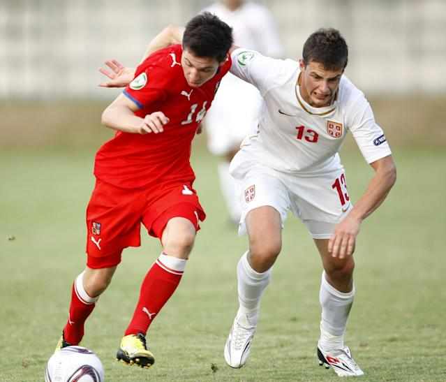 Czech's Tomas Prikryl (L) vies with Serbia's Aleksandar Pantic (R) during their football final match of UEFA European Under-19 Championship 2010/2011 in Mogosoaia village, next to Bucharest, on July 29, 2011. AFP PHOTO / STRINGER (Photo credit should read STRINGER/AFP/Getty Images)