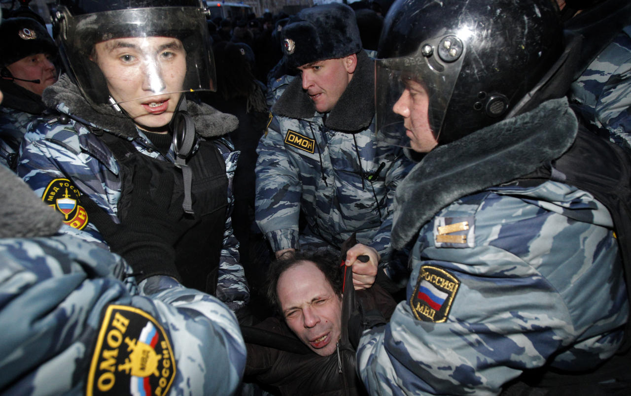 Russian police officers detain an opposition protester during a protest near the Central Election Committee in Moscow, Monday, March, 5, 2012. Demonstrators are contesting the outcome of the vote, pointing to a campaign heavily slanted in Putin's favor and to reports of widespread violations in Sunday's ballot. (AP Photo/Ivan Sekretarev)