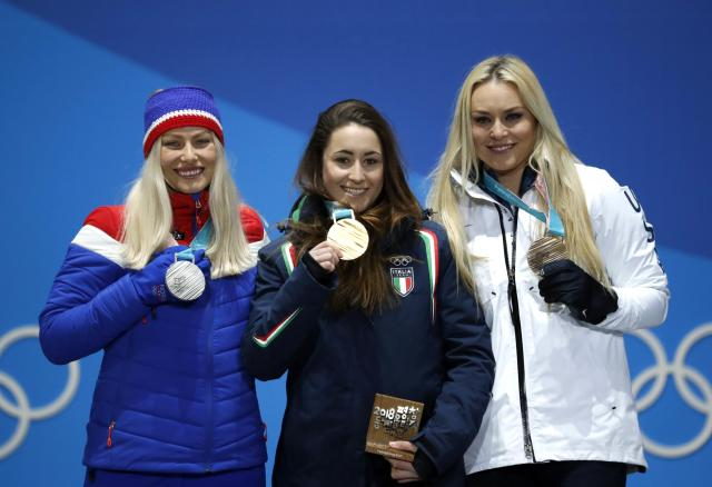 Medals Ceremony - Alpine Skiing - Pyeongchang 2018 Winter Olympics - Women's Downhill - Medals Plaza - Pyeongchang, South Korea - February 21, 2018 - Gold medalist Sofia Goggia of Italy, silver medalist Ragnhild Mowinckel of Norway and bronze medalist Lindsey Vonn of the U.S. on the podium. REUTERS/Kim Hong-Ji