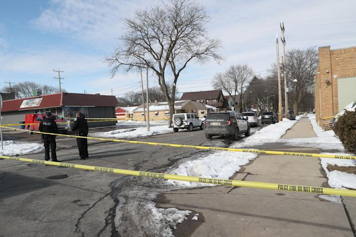Police close off the streets as they investigate three bodies found Sunday in the 4700 block of West Burleigh Street in Milwaukee.