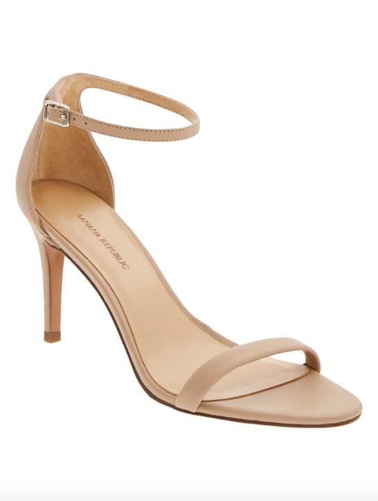 """<p>No matter what the season, a <a href=""""https://www.popsugar.com/buy/Bare-High-Heel-Sandal-536123?p_name=Bare%20High%20Heel%20Sandal&retailer=bananarepublic.gap.com&pid=536123&price=60&evar1=fab%3Aus&evar9=47052447&evar98=https%3A%2F%2Fwww.popsugar.com%2Fphoto-gallery%2F47052447%2Fimage%2F47052448%2FBare-High-Heel-Sandal&list1=banana%20republic%2Cshoes%2Cfashion%20shopping&prop13=api&pdata=1"""" rel=""""nofollow"""" data-shoppable-link=""""1"""" target=""""_blank"""" class=""""ga-track"""" data-ga-category=""""Related"""" data-ga-label=""""http://bananarepublic.gap.com/browse/product.do?pid=672330012&amp;cid=1035406&amp;pcid=1027224&amp;vid=1&amp;grid=pds_55_63_1#pdp-page-content"""" data-ga-action=""""In-Line Links"""">Bare High Heel Sandal</a> ($60) is a versatile option that suits just about every style. </p>"""
