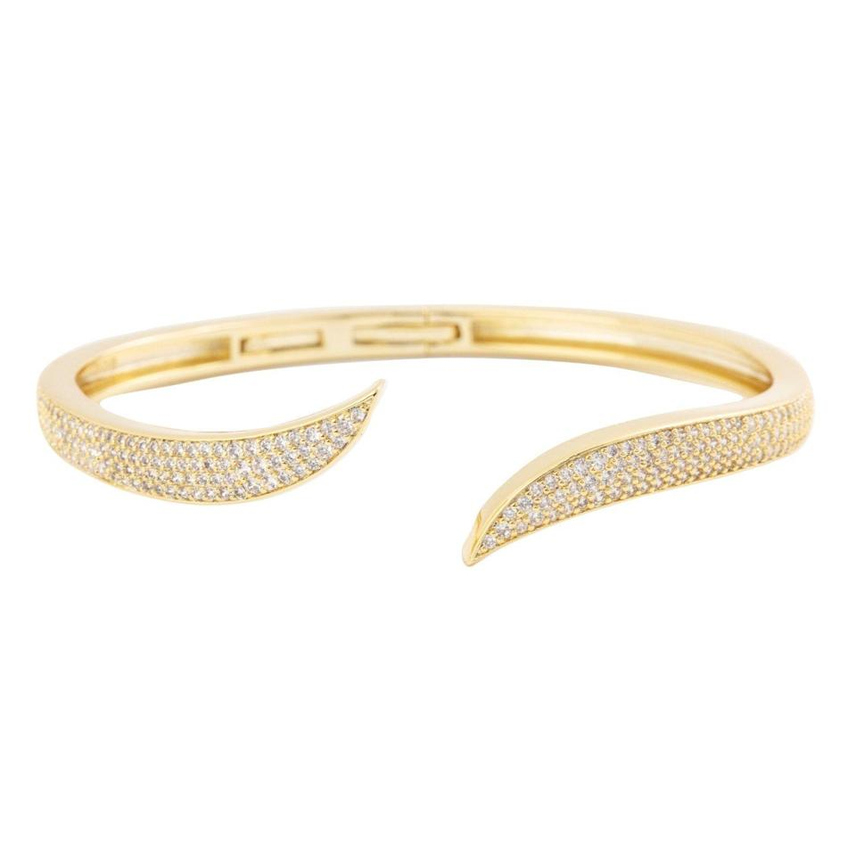 """<p><strong>Elise Paige</strong></p><p>elisepaigejewelry.com</p><p><strong>$110.00</strong></p><p><a href=""""https://elisepaigejewelry.com/collections/frontpage/products/copy-of-swirl-cuff-pre-order"""" rel=""""nofollow noopener"""" target=""""_blank"""" data-ylk=""""slk:Shop Now"""" class=""""link rapid-noclick-resp"""">Shop Now</a></p><p>Offering a whole new definition to <em>cuffing season,</em> this diamond cuff will become your new best friend.</p>"""