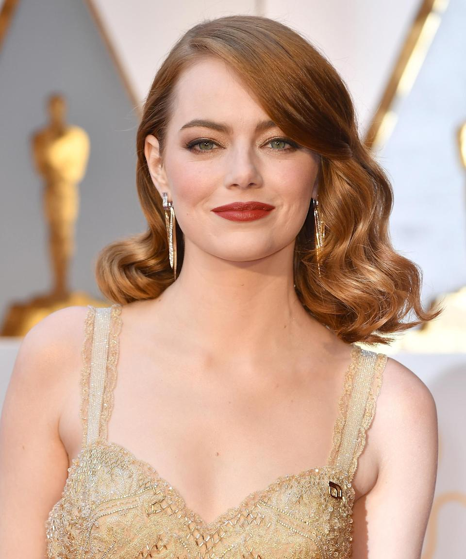 "<strong>Emma Stone, 2017</strong><br><br>When you're up for the biggest award in your field — and countless photographers will be taking your picture — it's about landing on a hairstyle that looks modern, yet feels timeless. Stone's stylist <a href=""https://www.instagram.com/mararoszak/?hl=en"" rel=""nofollow noopener"" target=""_blank"" data-ylk=""slk:Mara Rozak"" class=""link rapid-noclick-resp"">Mara Rozak</a> created a deep-cut lob that was both a nod to '30s Hollywood glamour and a style we all wanted to bookmark for later.<span class=""copyright"">Photo: Jeff Kravitz/WireImage.</span>"