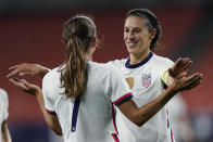 U.S. forward Carli Lloyd, right, congratulates Tobin Heath after Heath scored during the second half of the team's international friendly soccer match against Paraguay, Thursday, Sept. 16, 2021, in Cleveland. The United State won 9-0. (AP Photo/Tony Dejak)
