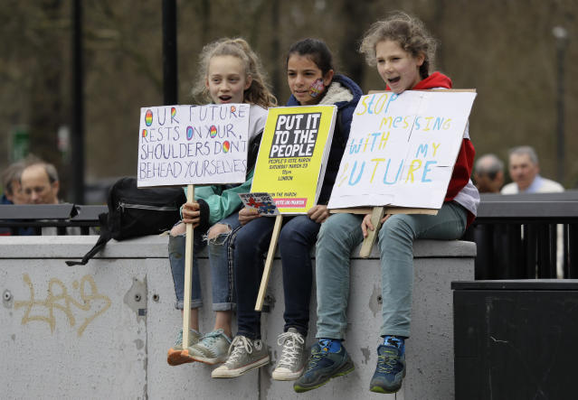 Children wait for the start of a Peoples Vote anti-Brexit march in London, Saturday, March 23, 2019. The march, organized by the People's Vote campaign is calling for a final vote on any proposed Brexit deal. This week the EU has granted Britain's Prime Minister Theresa May a delay to the Brexit process. (AP Photo/Kirsty Wigglesworth)