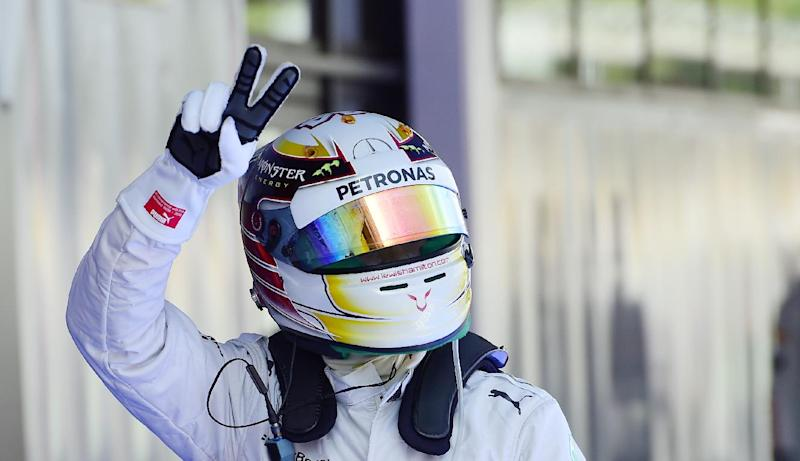 Mercedes driver Lewis Hamilton of Britain gestures after setting the pole position in the qualifying session ahead of the Spain Formula One Grand Prix at the Barcelona Catalunya racetrack in Montmelo, near Barcelona, Spain, Saturday, May 10, 2014. Lewis Hamilton earned his fourth pole position of the Formula One season Saturday as Mercedes was again in a class of its own in qualifying for the Spanish Grand Prix, while four-time champion Sebastian Vettel was left stranded by his faulty Red Bull. Hamilton clocked a leading lap of 1 minute, 25.232 seconds on the Barcelona-Catalunya circuit for his 35th career pole. (AP Photo/Manu Fernandez)