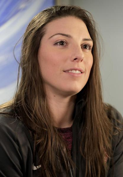 FILE - In this Feb. 7, 2017, file photo, WNHL player Hilary Knight answers questions during an interview in New York. The U.S. women's hockey team is threatening to boycott the world championships because of a wage dispute. The team announced Wednesday that they will not participate in the International Ice Hockey Federation tournament that begins March 31, 2017, in Plymouth, Michigan. (AP Photo/Julie Jacobson, File)