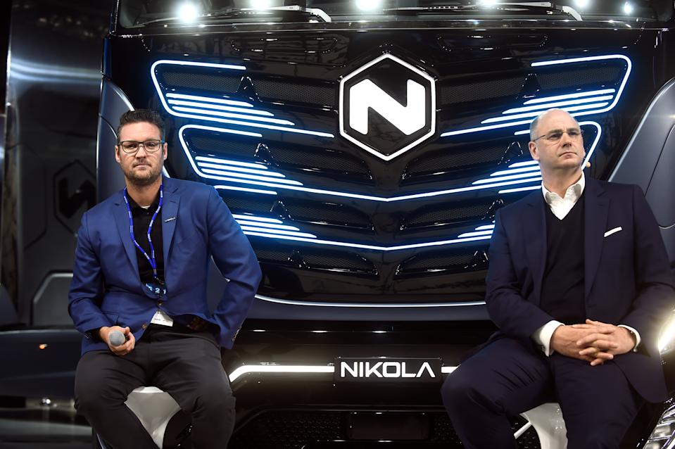 CEO of Italian-American CNH Industrial Hubertus Muhlhauser and CEO and founder of U.S. Nikola Trevor Milton attends a news conference held to presents its new full-electric and hydrogen fuel-cell battery trucks in partnership with U.S. Nikola, at an event in Turin, Italy, December 3, 2019. REUTERS/Massimo Pinca