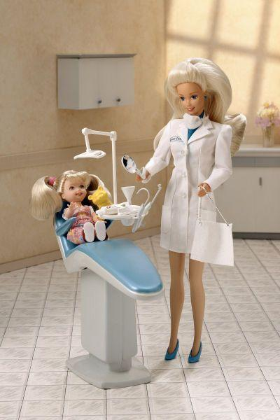 "<p>Enviably full hair and blue heels add style to Dentist Barbie's work ensemble.</p><p><a href=""http://www.goodhousekeeping.com/beauty/hair/tips/g996/90s-hairstyles/"" rel=""nofollow noopener"" target=""_blank"" data-ylk=""slk:'90s hairstyles we'd still wear today »"" class=""link rapid-noclick-resp""><em>'90s hairstyles we'd still wear today »</em></a></p>"