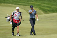 Cameron Champ, right, and caddie Chad Reynolds make their way up the 11th fairway during the final round of the 3M Open golf tournament in Blaine, Minn., Sunday, July 25, 2021. (AP Photo/Craig Lassig)