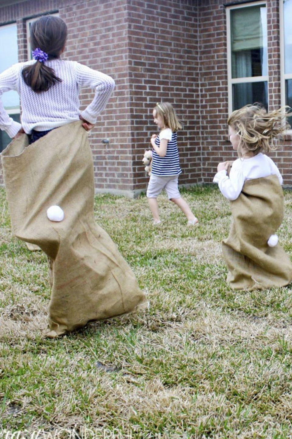 "<p>Hours of Easter fun, here we come! All you need to create this fun outdoor game is a burlap sack and a little white ""tail."" </p><p><strong>Get the tutorial at <a href=""https://www.crazy-wonderful.com/bunny-birthday-party/"" rel=""nofollow noopener"" target=""_blank"" data-ylk=""slk:Crazy Wonderful"" class=""link rapid-noclick-resp"">Crazy Wonderful</a>. </strong></p><p><strong><a class=""link rapid-noclick-resp"" href=""https://www.amazon.com/Large-Burlap-Bags-Potato-Obstacle/dp/B07HGJQKYT?tag=syn-yahoo-20&ascsubtag=%5Bartid%7C10050.g.3100%5Bsrc%7Cyahoo-us"" rel=""nofollow noopener"" target=""_blank"" data-ylk=""slk:SHOP BURLAP SACKS"">SHOP BURLAP SACKS</a></strong></p>"