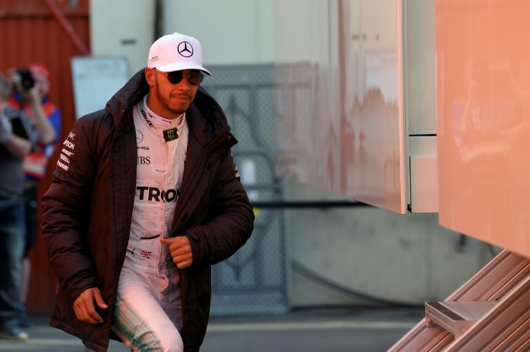 Mercedes driver Lewis Hamilton walks at the Circuit de Catalunya on March 9, 2017 on the outskirts of Barcelona during tests ahead of the Formula One Grand Prix season