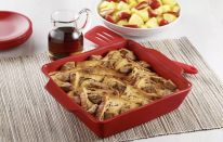 """<p>Instead of laboring away dipping and flipping, this recipe builds all the flavors and warm gooeyness of French toast in one pan. </p> <p><a href=""""https://www.thedailymeal.com/best-recipes/easy-cinnamon-french-toast-recipe?referrer=yahoo&category=beauty_food&include_utm=1&utm_medium=referral&utm_source=yahoo&utm_campaign=feed"""" rel=""""nofollow noopener"""" target=""""_blank"""" data-ylk=""""slk:For the Easy Cinnamon French Toast Casserole recipe, click here."""" class=""""link rapid-noclick-resp"""">For the Easy Cinnamon French Toast Casserole recipe, click here.</a></p>"""