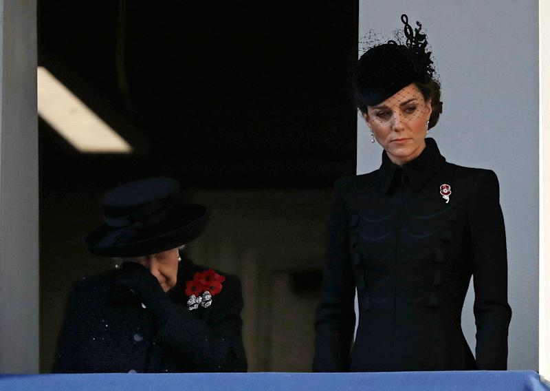 Queen Elizabeth II wipes her eye as she stands with Duchess Kate to watch the Remembrance Sunday ceremony at The Cenotaph in London on Nov. 10, 2019.