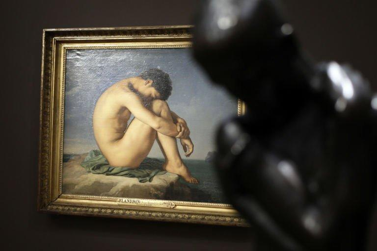"A picture taken on September 23, 2013 in Paris shows a painting by French artist Jean-Hippolyte Flandrin at the ""Masculin/Masculin"" exhibition at the Orsay Museum"