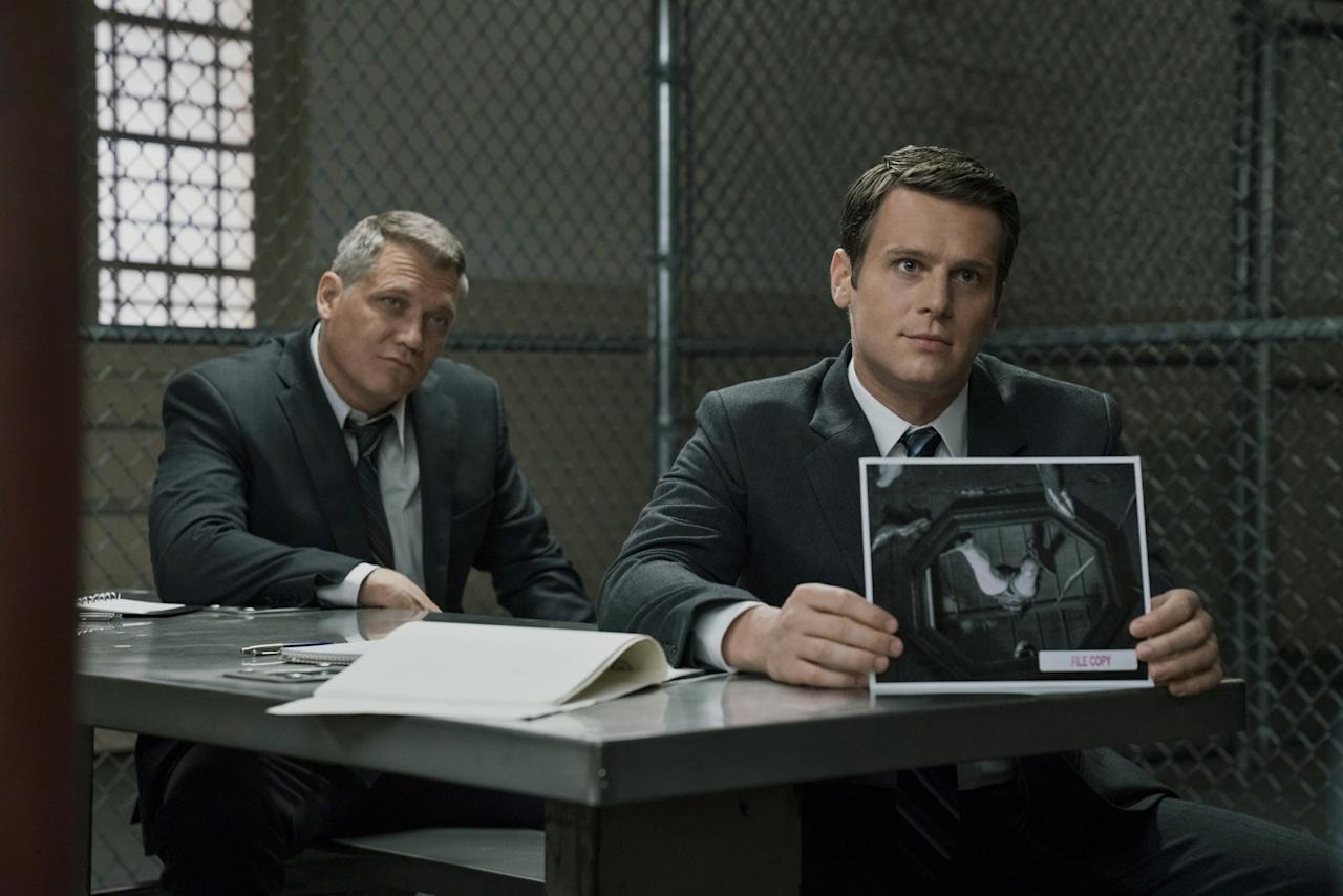 """<p>Jonathan Groff stars in the true-crime series <strong>Mindhunter</strong> as Holden Ford, an agent who starts up a unit investigating <a href=""""https://www.popsugar.com/entertainment/Mindhunter-Serial-Killers-Real-Life-44174726"""" class=""""ga-track"""" data-ga-category=""""Related"""" data-ga-label=""""http://www.popsugar.com/entertainment/Mindhunter-Serial-Killers-Real-Life-44174726"""" data-ga-action=""""In-Line Links"""">serial killers</a>. Most of the time, Ford simply talks to the murderers, but many of them act unpredictably, such as Charles Manson and Edmund Kemper. </p> <p><a href=""""https://www.netflix.com/title/80114855"""" target=""""_blank"""" style=""""background-color: rgb(255, 255, 255);"""" class=""""ga-track"""" data-ga-category=""""Related"""" data-ga-label=""""https://www.netflix.com/title/80114855"""" data-ga-action=""""In-Line Links"""">Watch <strong>Mindhunter</strong> on Netflix.</a></p>"""